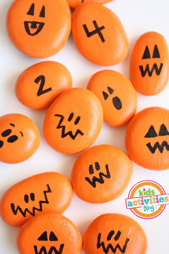 How to make fun Halloween pumpkin painted rocks. Plus, a fun game to play with them!