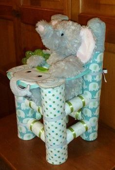 Elephant in a high chair diaper cake - A diaper cake is one of the best baby shower gift ideas and ideal for baby shower decor.