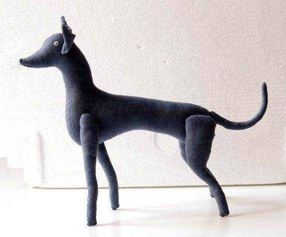 This dog made from natural linen. Inside - polyester stuffing.  * Hand embroidered body.    Body ~38 x 30 cm -14,19x 11,8 inch This dog can be an
