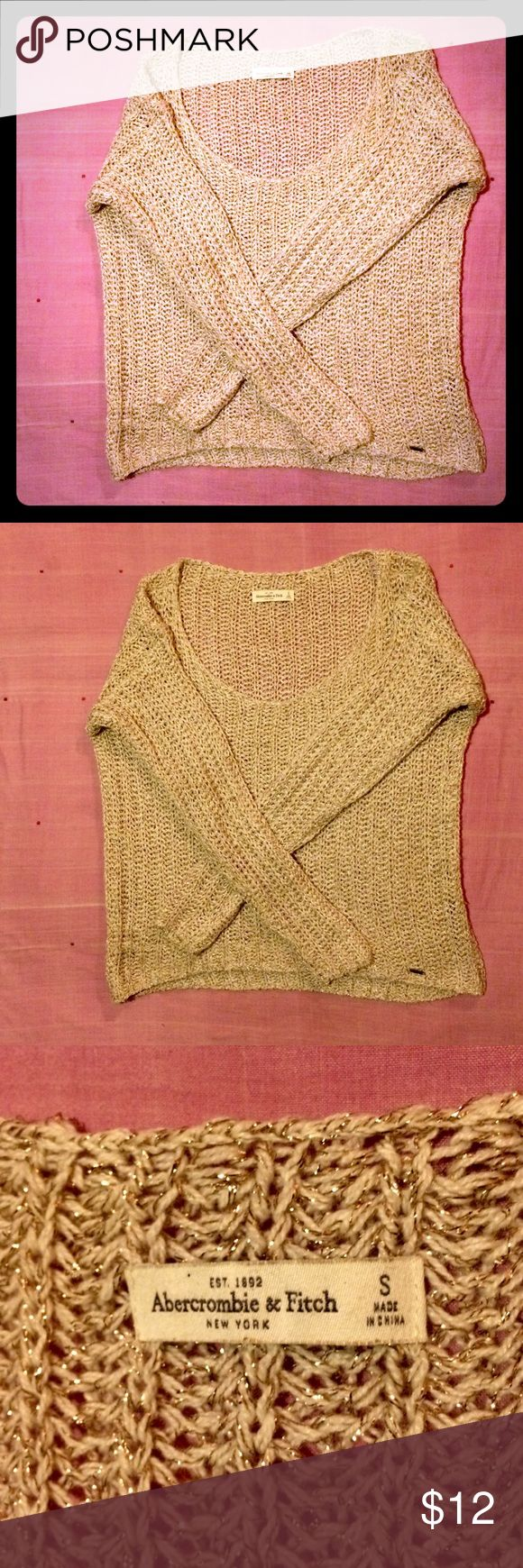 A&F loose knit sweater with gold Abercrombie and Fitch loose knit sweater with golden metal fibers size small preowned still in good condition. Bundle and safe.  Thanks for looking at my closet, please come back, I'll be posting more 💕 Abercrombie and Fitch Sweaters Crew & Scoop Necks