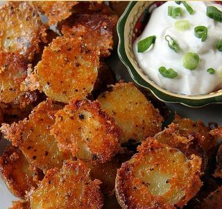 """Crispy Parmesan Potatoes --  In Bowl - Parmesan Cheese, Garlic Powder, Paprika, and Oregano  Pour """"Bowl"""" in a baking dish. Slice your Potatoes and place CUT SIDE DOWN into the dish. Bake 400 for 40 minutes... and... wait... that's it :)"""