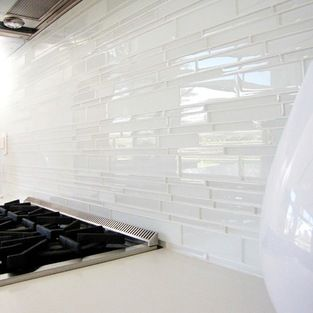 love this glass tile backsplash-- could paint watercolor style on Wall and then put these up. Could have an interesting effect. (Stain the putty ?)