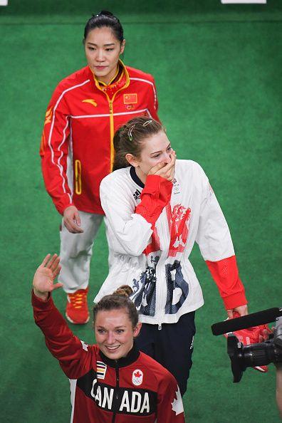 #RIO2016 Gold medallist Rosannagh MacLennan of Canada silver medallist Bryony Page of Britain and bronze medallist Li Dan of China walk toward the podium...