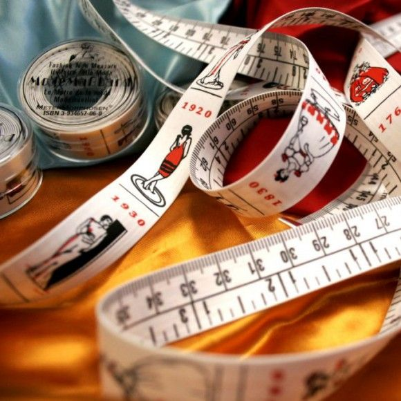 The Flexible Tailor's Fashion Tape Measure. Covers 300 years of fashion history, representing each decade.