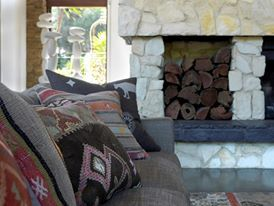 Scatter cushions in living room designed by MR. MITCHELL