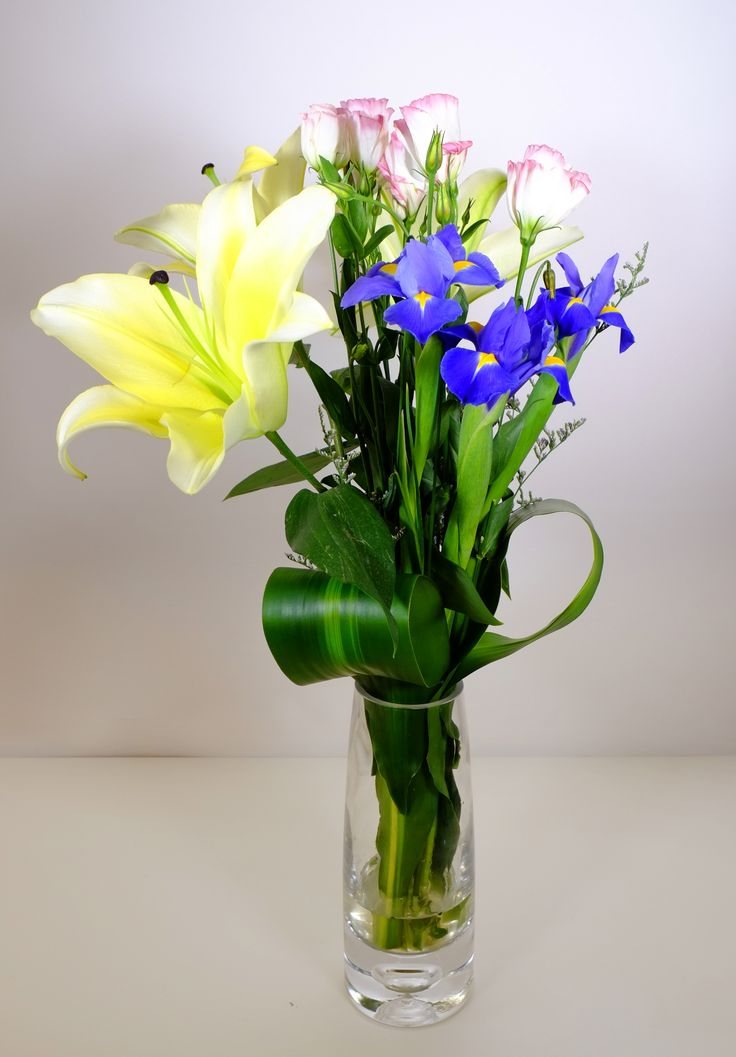Enlighten Someones with this charming mixture of fluffy white lilies, violet irises, ballerina pink lisianthus. Sends this gift that shows them the love.  Shop Now, Save 15% Off on All Flowers Arrangements! See more at: http://www.timesflora.com/  #flowers #florist #Australia #timesflora #delivery