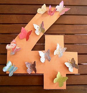 Number party decor for butterfly party alternative to draping butterflies making the number. This is a simpler idea