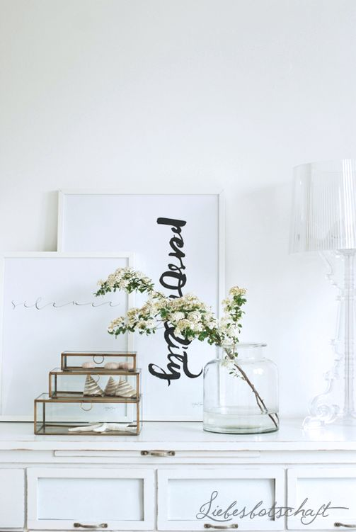 fresh and light tablescape / glass boxes and vase; white frames, table and flowers
