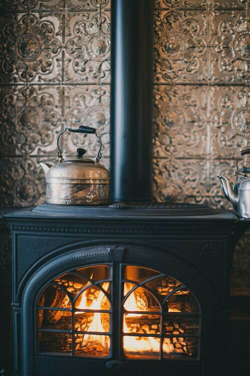 Sitting next to a wood fire burning stove is where I would like to be!
