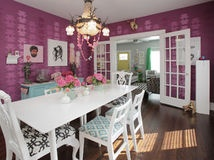 A kaleidoscope of colors on walls, furniture and fabrics brings an energetic spirit to a 1920s colonial in Texas