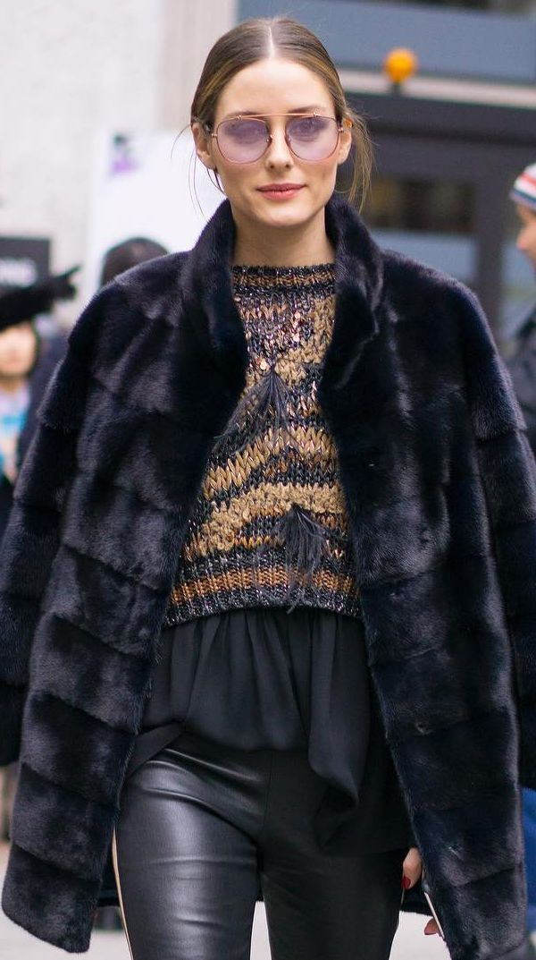 Who made  Olivia Palermo's sunglasses, feather brown stripe sweater, leather pants, and black coat?