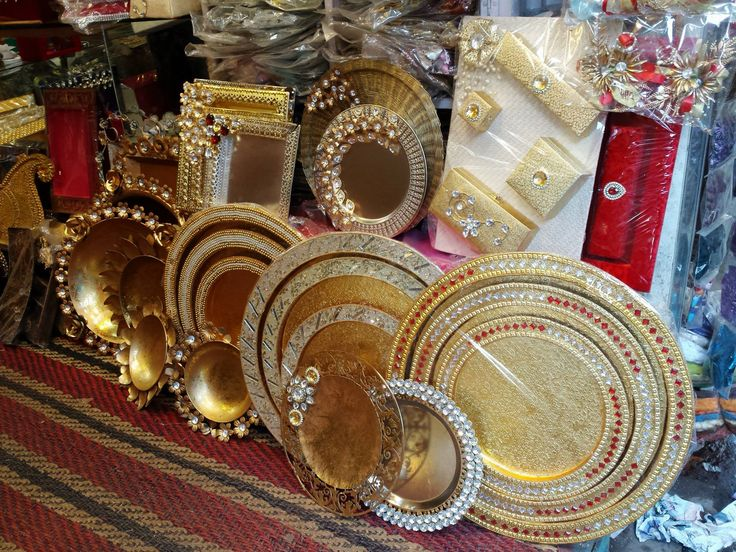 Plates and bowls for use in Indian weddings, at Kinari Bazaar. They're blingy beyond belief and (relatively) inexpensive. Perfect for one-time use, for example, for Diwali gifting, when you need to send dry fruits and sweets. The little boxes are great for gifting jewellery.