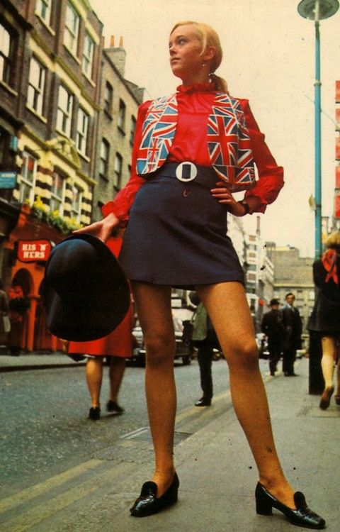 1960's fashion shoot, London. Girl in mini skirt & Union Jack waistcoat.
