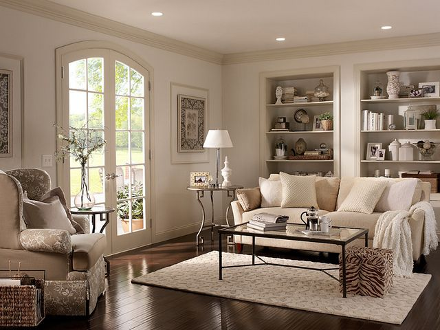 We love the look of lighter white walls with darker white trim. Add in neutral furniture and dark wood floors and you have a cozy living room space.  Walls: Cotton Knit UL170-13 Ceiling: Silky White UL170-12 Trim: Roman Plaster UL170-11 Alcoves inside: Parachute Silk UL160-16