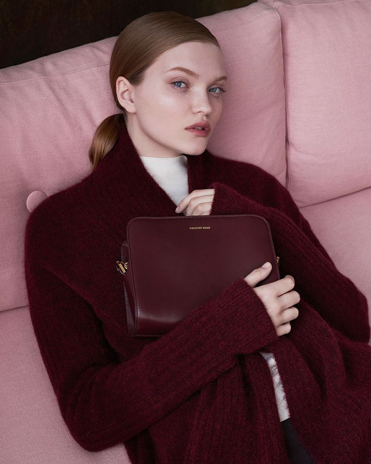 Complete the tonal play with burgundy accessories and beautifully smooth leather.