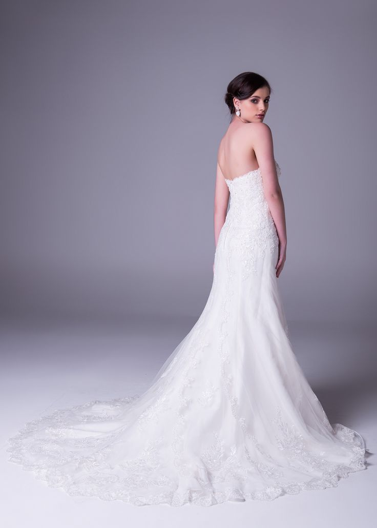 We know. Amazing! :-) Click to book a free fitting in this #strapless #sheath #lace #wedding dress. Style >> WPD17650