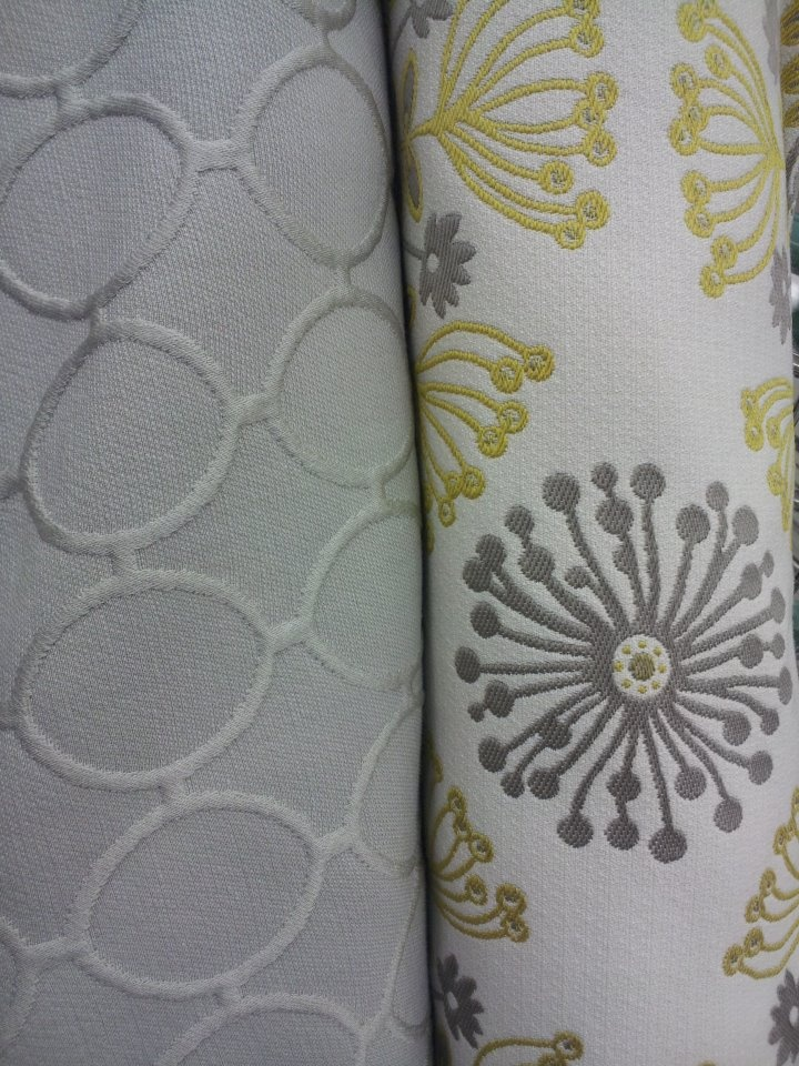 Fabric for the new house. Recovering an ottoman and making throw pillows. Solid gray is for the ottoman and the gray and yellow patterned one is for throw pillows. :)