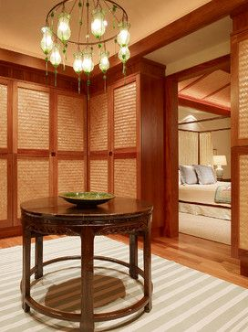 Dressing room with lots of closed storage  |  via Houzz Kanae Lot 1 tropical closet