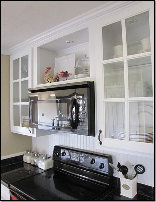open cabinet above microwave