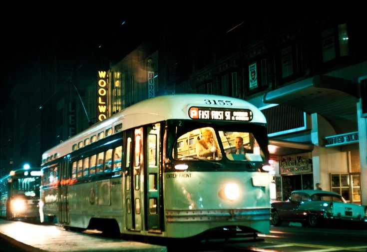 the last evening of operation of streetcars in the city of Los Angeles, March 31, 1963, as the Metropolitan Transit Authority (the predecessor to today's MTA) prepares to shut down the entire remaining rail system. Here, MTA PCC no. 3155 rests at 7th and Broadway on the P Line