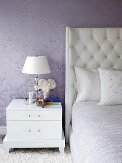 love Gwyneth's Hampton house bedroom here w/lavender walls, creamy, tufted bed & white table