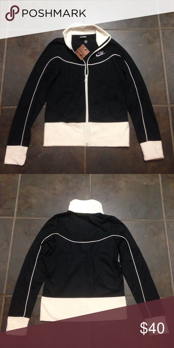 Black Nike zip up. NWT This black and cream zip up is ready for a new winter home. I bought this and never wore it. NWT. Offers welcome! Nike Tops