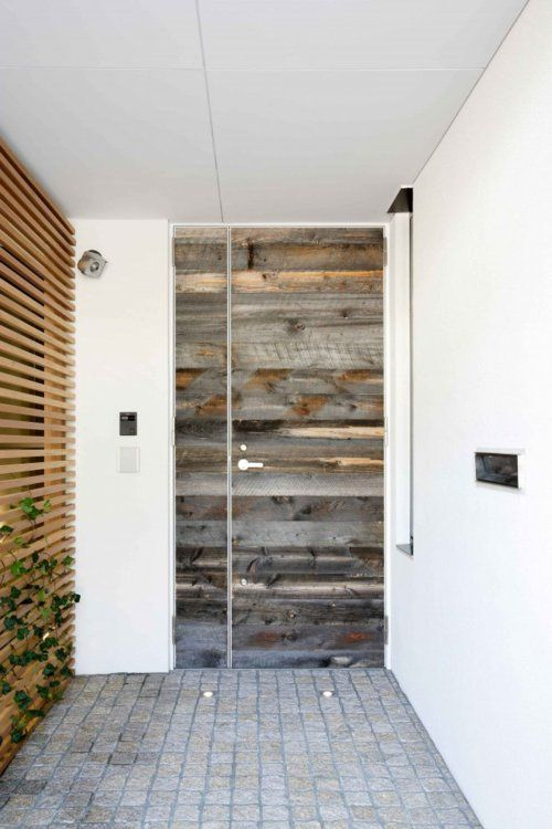 I want to come to this home's front entrance everyday. Well...and my lady #kjt behind the door too;) Amazing re-purposing of wood. The slat wall to the left is dope and the mix of brand-spankin' new with the textures make me very happy.
