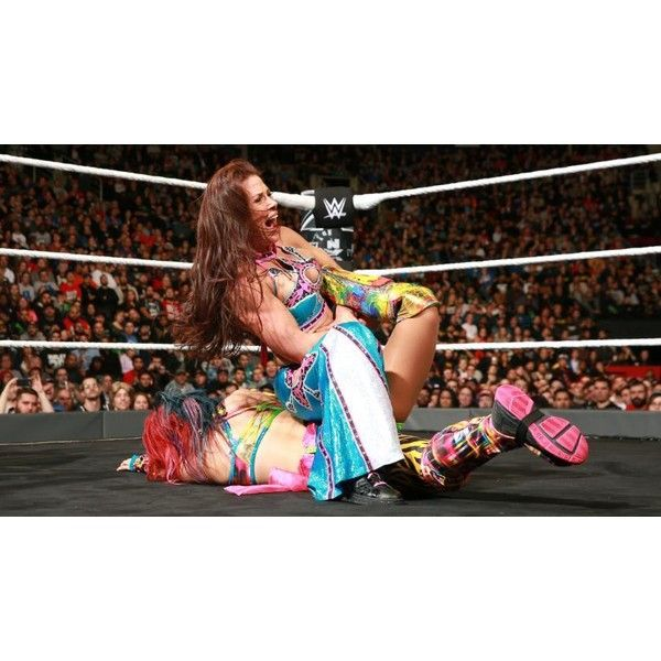 Photos: Mickie James' return at NXT TakeOver ❤ liked on Polyvore featuring home and home decor
