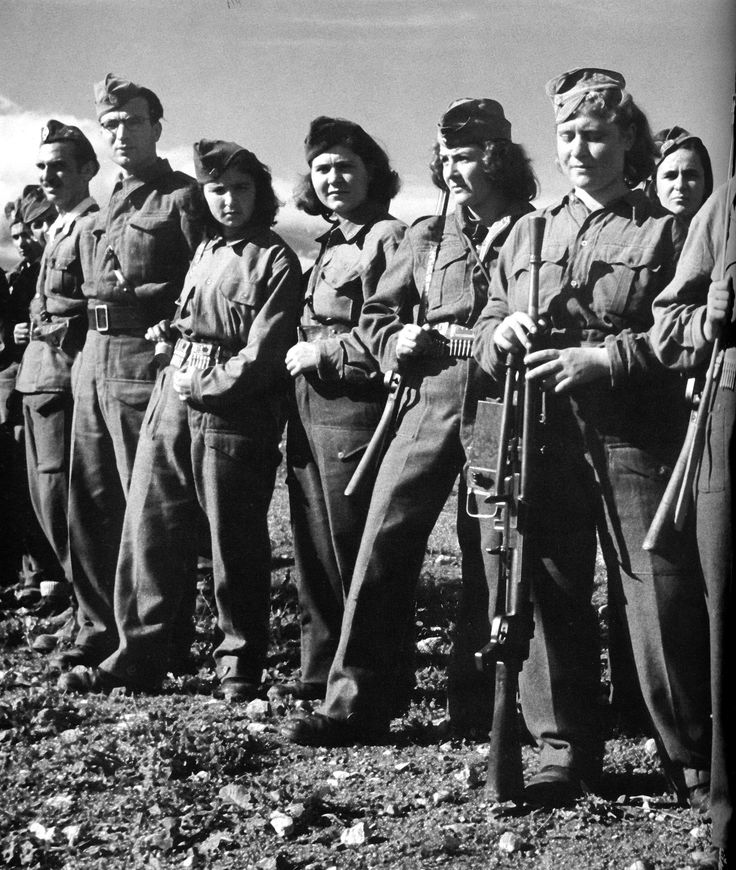 Greek women partisans of the ELAS communist resistance join their men comrades during parade somewhere in the mountains of central Greece, 1943.