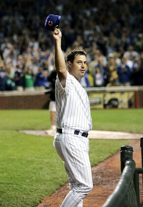 Greg Maddux tipped his hat after reaching 3,000 strikeouts in the third inning against Omar Vizquel of the San Francisco Giants at Wrigley Field on July 26, 2005. Maddux pitched for the Cubs from 1986 to 1992 and from 2004 to 2006. He won the Cy Young Award in 1991
