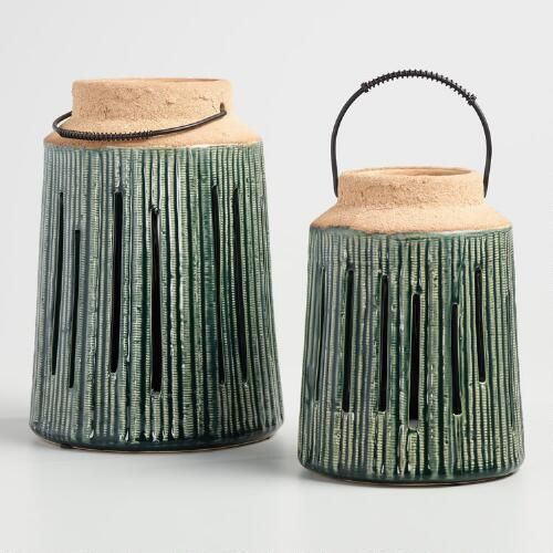 Our handcrafted lantern boasts a ribbed pattern, a subtle gloss glaze, and an unfinished bisque top for an intentionally timeworn look. This rustic piece is available in two sizes and multiple colors for an array of display options.