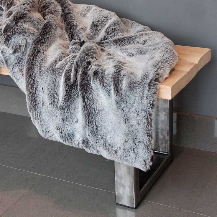 This is seriously the softest silkiest grey Alaskan fox faux fur throw you'll ever see available from Ineko Home
