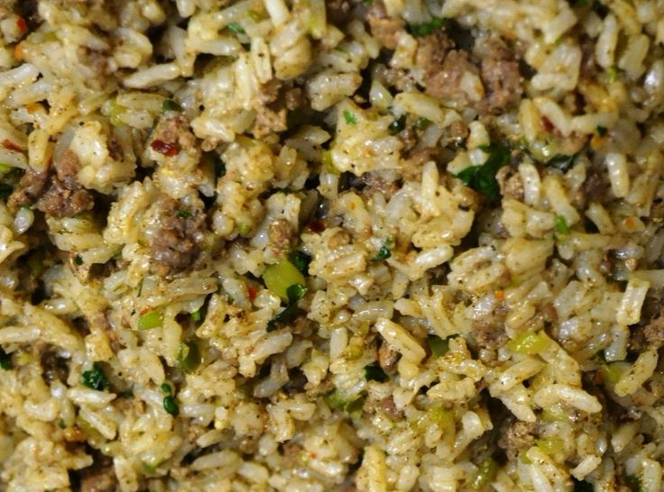 """Cajun rice or """"dirty rice"""" is a well loved New Orleans dish and a Louisiana classic, with as many different recipes as there are cooks. Traditional Dirty Rice uses chopped chicken livers which gives it a distinctive flavor and a dark color dubbing it """"dirty"""" rice. It typically includes the trinity with da' Pope, which is diced bell pepper, celery, onion, and garlic. This is my favorite version."""