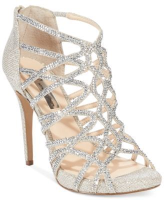 Add some sparkle to your night. The Sharee high heel evening sandals by Inc International Concepts. | Imported | Rhinestone Covered Knit Fabric upper | Peep Toe Caged high heel evening sandals with fu
