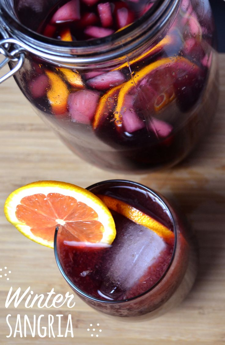 Winter Sangria - Sangria is one of our favorite drinks for holidays or large get togethers. Filled with cara cara oranges, pears and Satsuma mandarin juice, this sangria is citrusy-sweet and oh so delicious!