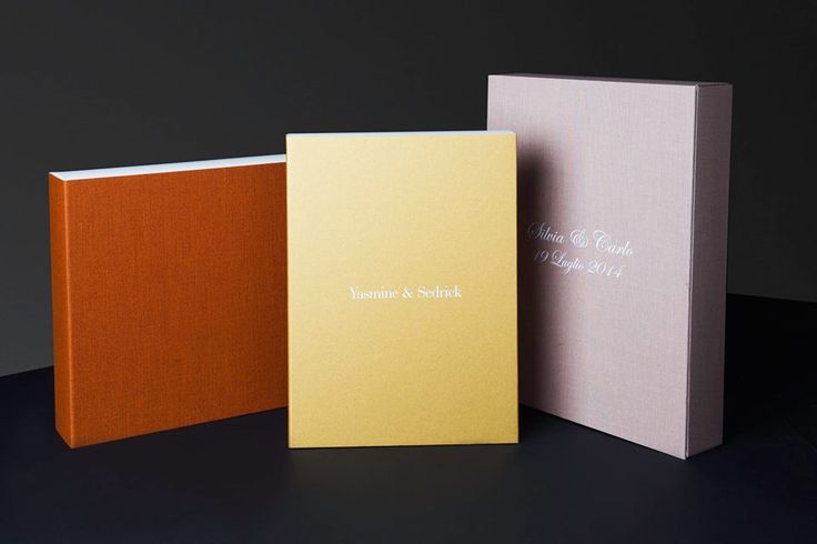 #studiobox is one of the most simple box in Graphistudio range. The book is perfectly encapsulated and protected by a precise magnetic closing system and can be lifted easily thanks to a satin ribbon. Each case can optionally be customized with the color overprinting of names, date or any other text.