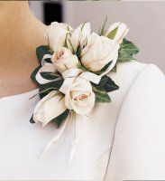 mother of the bride/groom corsage - white roses. Can be worn as a pin or on the wrist depending on preference
