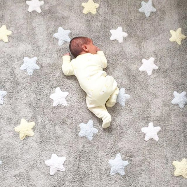 This adorable baby shows off how safe Lorena Canals rugs are for babies. Machine-washable and non-toxic for the drooliest of babies. Tricolor stars rug from lorenacanals.com