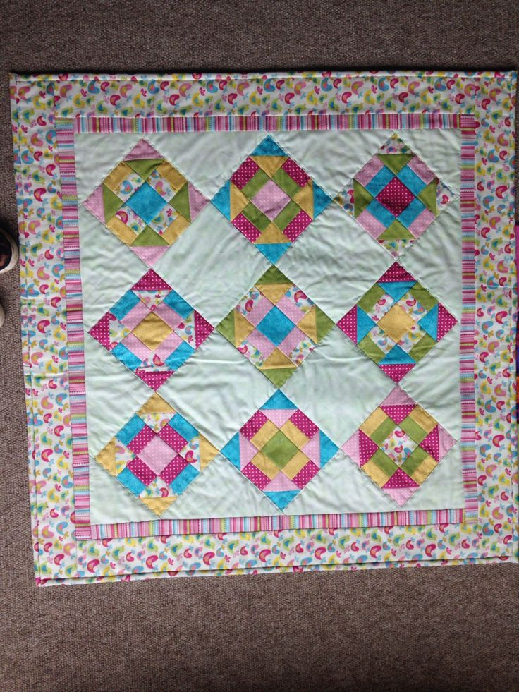 Hand made quilting. Made by my mum. For a 1 year old baby girl. So damn pretty.
