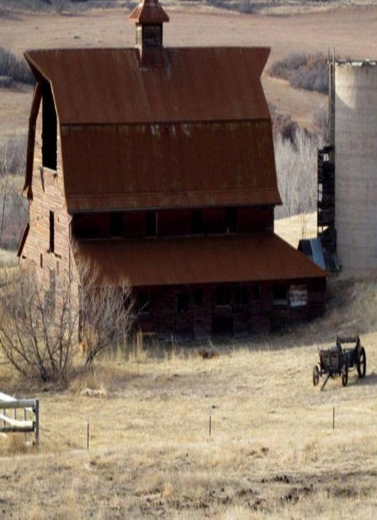 Weathered barn w/ corrugated metal roof