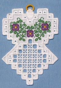 Hardangish Floral Angels from Laura's Sewing Studio. Yes you can do hardanger on your embroidery machine! 4x4 or 5x7 sizes and lots of other beautiful things available. Join her Yahoo Group for samples in your email if you choose INDIVIDUAL emails. Love her work.