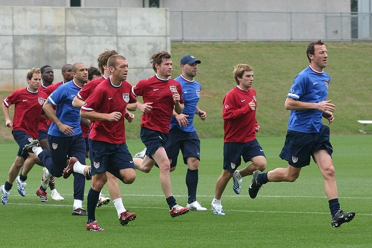Members of the United States men's national soccer team during a practice session prior to the 2006 World Cup. L-to-R: Eddie Lewis, Eddie Johnson, Eddie Pope, Tim Howard, (not visible), (not visible), Jimmy Conrad, Brian McBride, Marcus Hahnemann, Bobby Convey, team coach (unidentified).