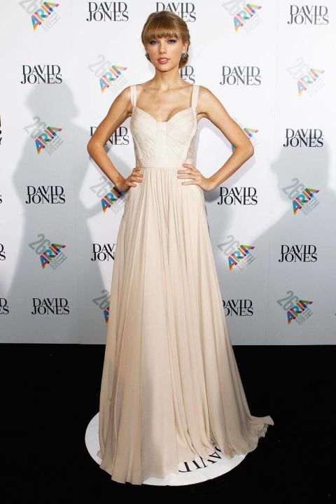 In Elie Saab at the 26th Annual ARIA Awards in Sydney, Australia. See Taylor Swift's full fashion evolution, from sequins in 2007 to her many crop tops today.