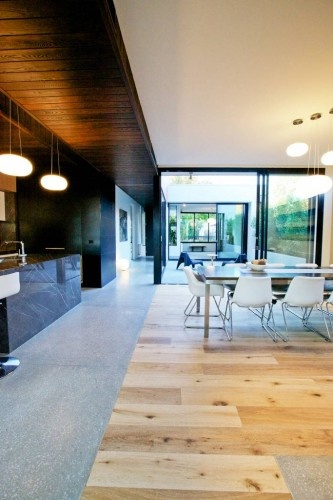 Jost Architects Love the polished concrete & timber floor integration.