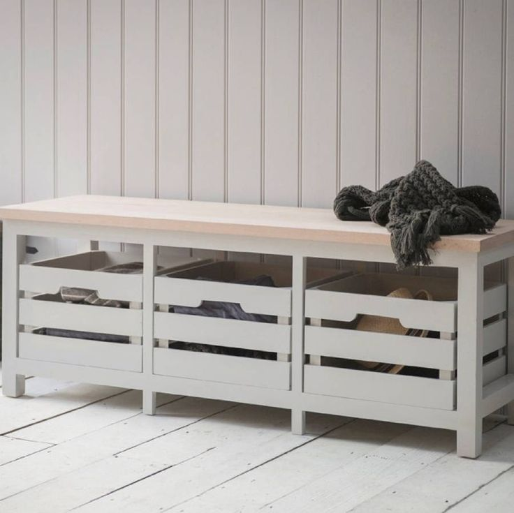 PLEASE NOTE DELIVERY WILL BE W/C 14TH SEPTEMBER It's just the job for tidying away all those shoes or scarves and hats and keeping them to hand yet out of sight. Designed to offer a bit more space than our smaller model, this Storage Bench has three handy pull out crates rather than two. With its clean lines, it is built to last using spruce and beech and has three handy pull out crates. Finished in a neutral chalk colourway, it certainly has that rustic appeal as well as being wonderfully…