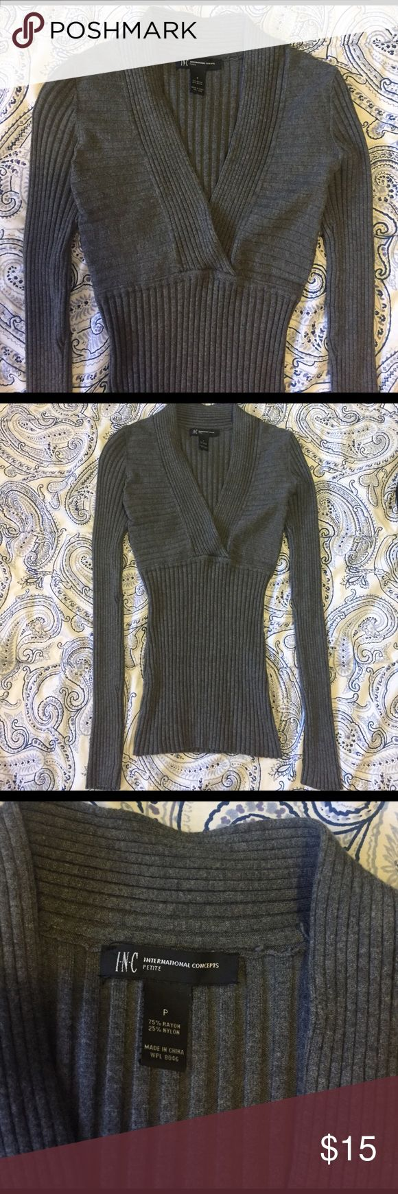 INC International Concepts gray petite sweater In very good condition. Fits like a petite small, and it does look very slim but it will stretch out when wearing. INC International Concepts Sweaters V-Necks