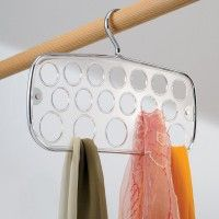 Interdesign Zia Scarf Holder. The Zia range of specialty storage hangers are made from high qualitychrome steel andclear resipream. This specialty hanger has 18 holes for storing many differing types of scarves and neck ware. Product Features:      High quality chrome steel     Clear resipream     18 storage holes  Dimensions H225mm x W340   http://www.lifespace.com.au/bedroom/specialty-hangers/interdesign-zia-scarf-holder  $23.95