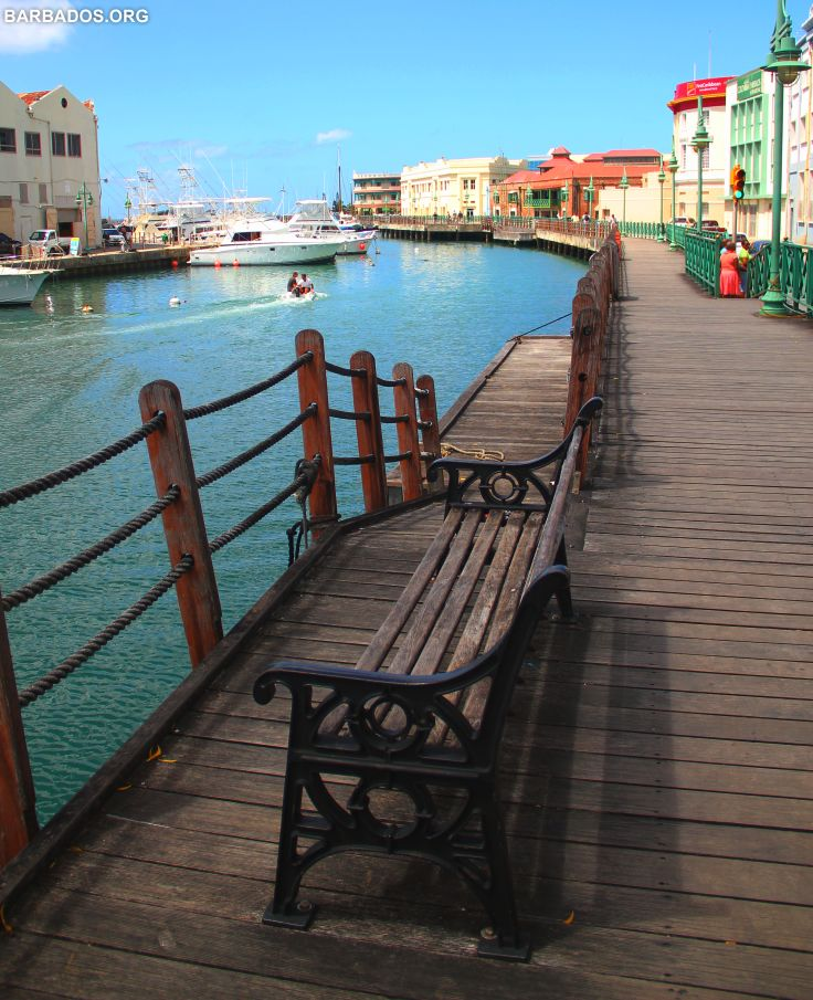 Sit and enjoy the waterfront view along the boardwalk in the capital city Bridgetown. #Barbados