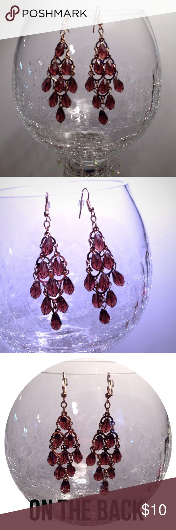 """NWT, Bronze Rose Gold Crystal Chandelier Earrings NWT, Adorable Gold chandelier earrings with layered bronze rose toned crystals. Lightweight long earrings are 3"""" long & 1"""" wide. Comes with 2 clear security backs on posts. Brand New with black velvet  jewelry bag, (shown in last picture). Price Firm Unless Bundled for an additional 10% discount. boutique Jewelry Earrings"""