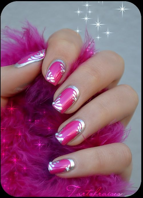 Magenta nail art with silver details, perfect for a pink prom dress